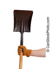 A gloved hand holding a shovel