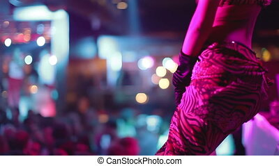 a gogo dancer performing on stage at a nightclub