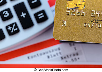 credit card, bank statement and calculator - a gold credit ...
