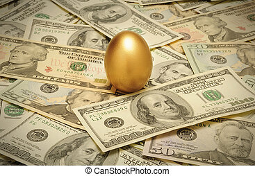 A gold nest egg sitting on a layer of cash of various American banknote denominations