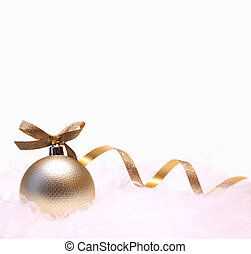 A golden christmas ball with a bow