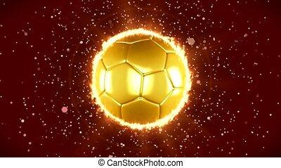 A golden football that spins.