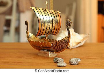 golden longboat - A golden longboat approaches