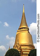 A golden Sri Lankan styled pagoda at the grand palace, ...