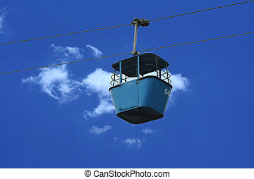 Gondola lift car against blue sky