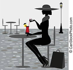 a good cocktail - silhouette woman sitting in a bar with a...
