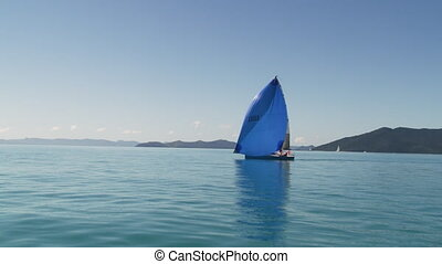 A gorgeous blue mast sailboat - A wide slow motion shot of a...