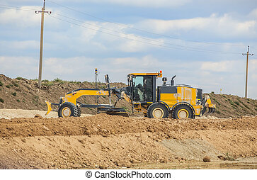 A grader is levelling the road. - road grader on the...