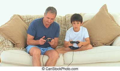 A grandfather playing video games