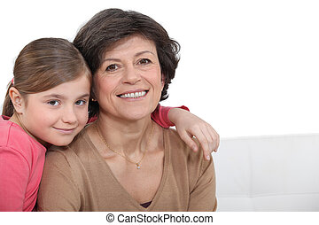 A grandma and her grand daughter.