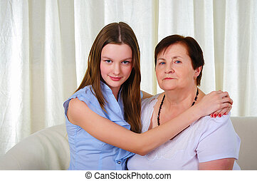 a grandmother with her young granddaughter