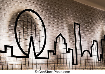 A graphic design with lighting on the wall