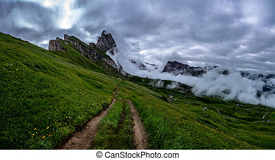 A gravel road to the peaks of the beautiful mountains of seceda.