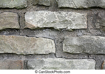 A gray brick wall background with mortar.