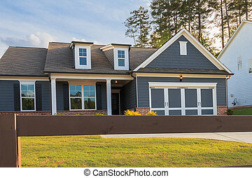 A gray ranch style model house