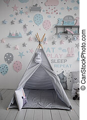 a gray wigwam in the children's room