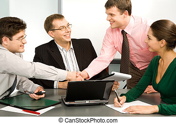Business people making a successful deal with the partners