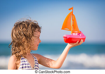 A great ship needs deep waters - Happy kid playing with toy...