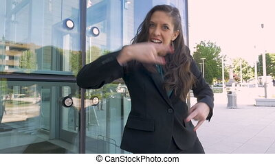 A greedy female business executive screaming and pointing at...