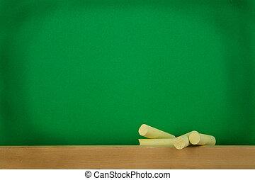 a green black-board is at school