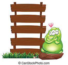 A green monster beside the empty wooden boards