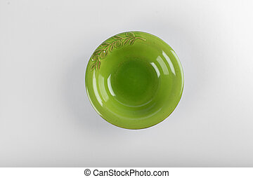 A green saucer isolated on white background