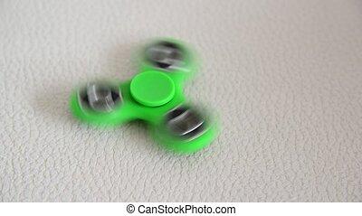 green spinner in motion - A green spinner in motion