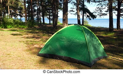 A green tent on the nature