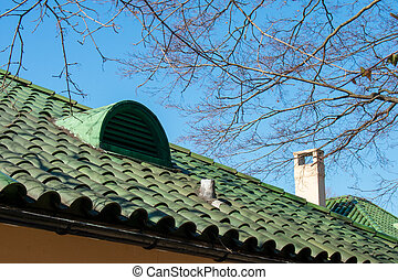 A Green Tile Roof On a Clear Blue Sky