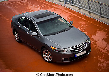 a grey metallic sedan