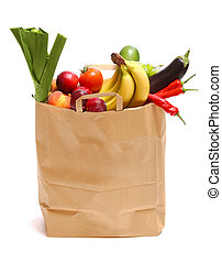 A grocery bag full of healthy fruits and vegetables on white
