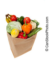 grocery sack full of vegetables on a white background