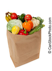 grocery sack full of vegetables on a white background - A...