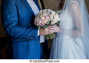 groom with bride and wedding bouquet
