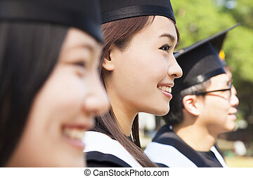 a group cheerful college graduates at graduation