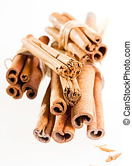 a group cinnamon sticks isolated on white