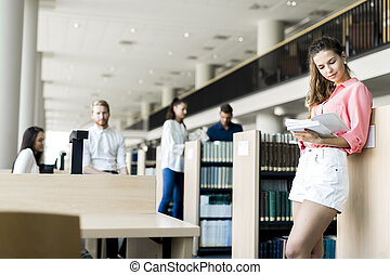 A group of academics studying in the library and conversing