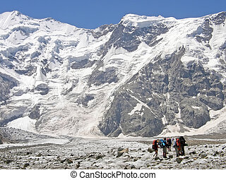A group of alpinists is in the mountains of Caucasus