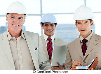 A group of architect smiling at the camera in a building