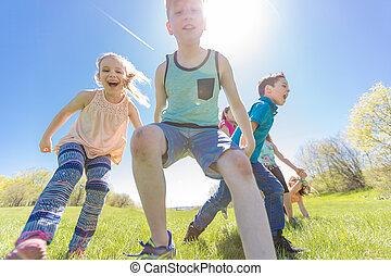 Group of child have fun on a field