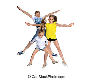 A group of children jumping and waving.