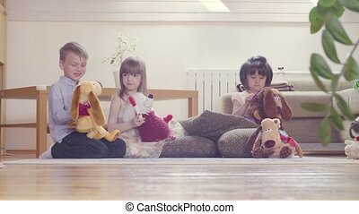 A group of children playing stuffed toys - A group of...