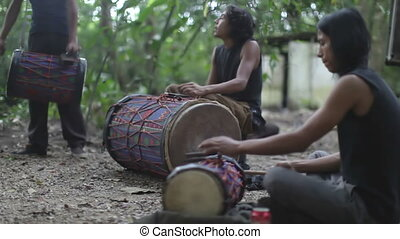 a group of drummers play in the jungle in palenque, mexico