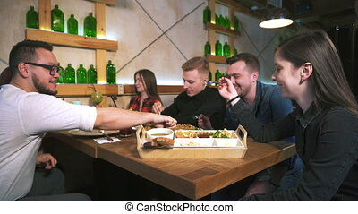 A group of friends at a restaurant having lunch.