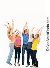 A group of friends cheering as they jump in the air and look at one another while smiling