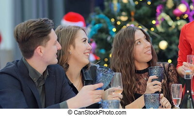 A group of friends listen to new Year's toast