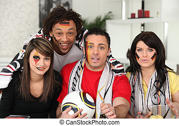 A group of friends supporting the German football team