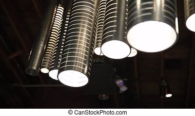A group of hanging lights with shallow depth of field.