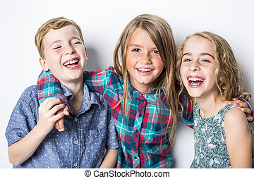 Group of happy children in studio gray background