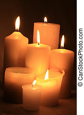 A group of ivory white candles in different sizes